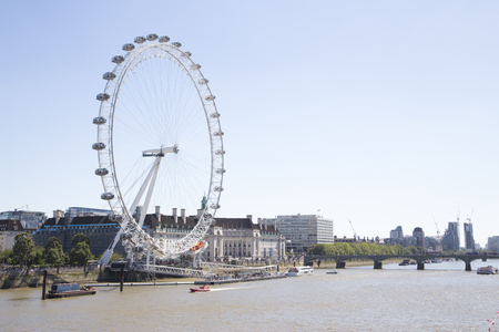 eye traveller: LONDON, UK - AUG 12, 2016. Coca cola London eye with Westminster bridge. Editorial