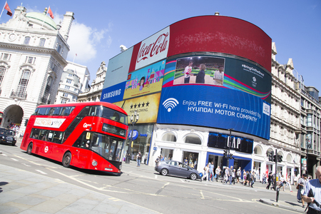 piccadilly: Bus drives past large screen tv in piccadilly circus