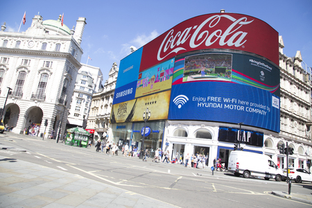 big screen: LONDON, UK - AUG 12, 2016. Big screen showing adverts and rio 2016 in piccadilly circus