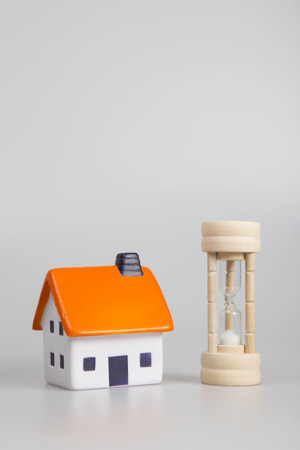 buying time: Concept of time and buying a house Stock Photo