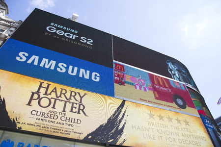 adverts: LONDON, UK - AUG 12, 2016. Large TV screen in piccadilly circus showing adverts