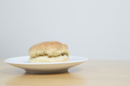 scone: Scone on a white plate with space for text