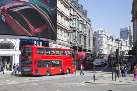 piccadilly: LONDON, UK - AUG 12, 2016. bus passing large screen in piccadilly circus Editorial
