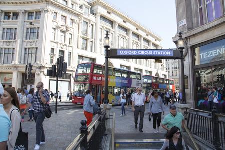oxford: Tourists enter Oxford circus underground station. Editorial