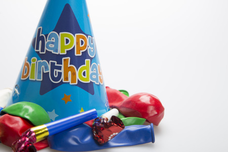 boys birthday party hat with balloons and party blowers