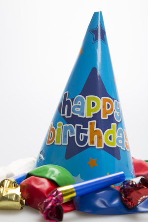 favour: Blue party hat with balloons on white background