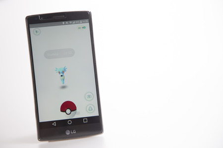 sighting: Hertfordshire, UK – August 26, 2016: LG G4 smart phone showing screen shot of nearby sighting on Pokemon Go, A very popular augmented reality app for iphone and android devices. Shot in a studio against a white background.