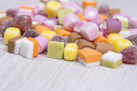 suger: Shallow focus of candy on a white surface Stock Photo