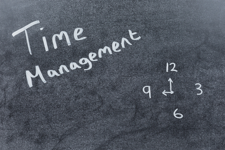 streamlining: Time Management concept with handwritten text on a chalkboard together with a doodle of a clock face and copy space Stock Photo