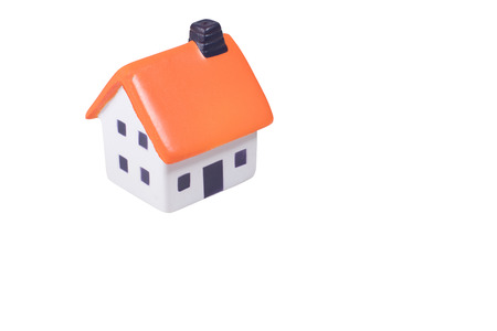 insurance themes: Small model house isolated on white for conceptual themes of ownership, insurance, purchase, sale and real estate with copy space Stock Photo