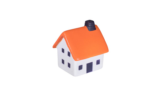roofed house: Little toy model of a red roofed house isolated on white viewed high angle with copy space alongside