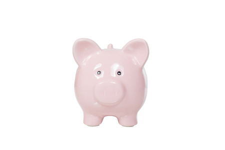 Isolated pink piggy bank facing the camera with white copy space alongside conceptual of financial, banking and savings themes