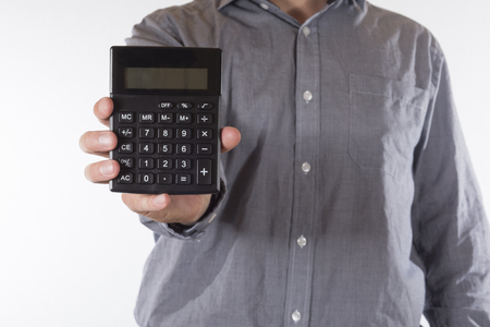 streamlining: Man holding out a small manual calculator with a blank readout towards the camera in a torso view on white