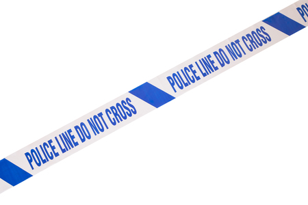 crime solving: Blue, angled police line do not cross crime scene tape and white copy space.