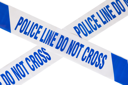Close up of blue police line do not cross crime scene tape forming a cross with white copy space.