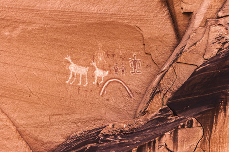 Old painted anasazi petroglyphs representing humans and animals, Canyon de Chelly, Arizona. Stock Photo