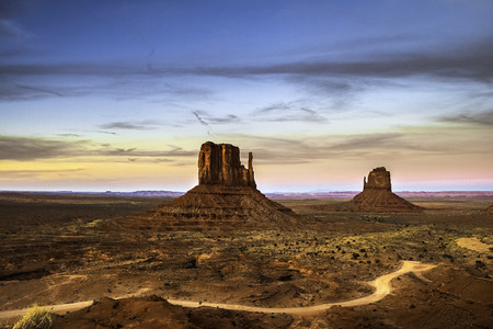 The West and the East Mitten Buttes in the Navajo Tribal Valley Monument in summer during a bright day of summer, Arizona. Stock Photo
