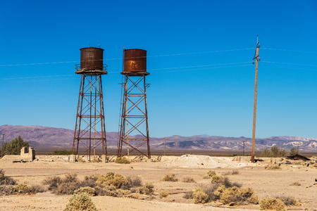 Rusty and weathered water tanks in Death Valley Junction, ancient railroad station in the Death Valley, California. Archivio Fotografico