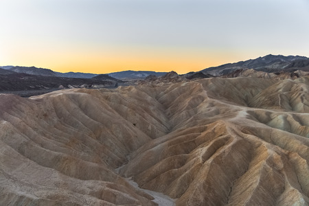 Sunrise on the famous mudstone and claystone of Zabriskie Point, Death Valley National Park, California.
