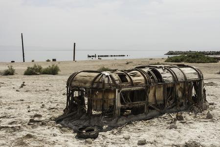 A torn, half buried and abandoned trailer in Salton Sea Beach, California - summer 2007.