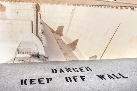 Warning information painted on wall at the Hoover dam, Nevada.