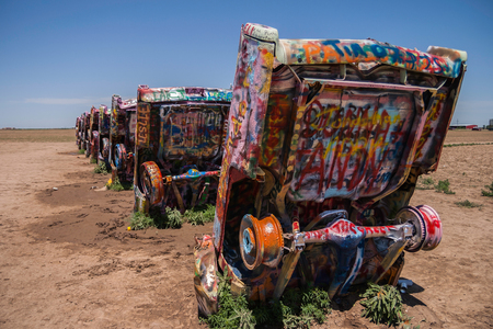 Famous Cadillac Ranch, public art and sculpture installation created by Lord Chip, Hudson Marquez and Doug Michels near Amarillo, Texas. Editorial