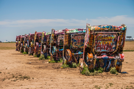 Famous Cadillac Ranch, public art and sculpture installation created by Lord Chip, Hudson Marquez and Doug Michels near Amarillo, Texas.