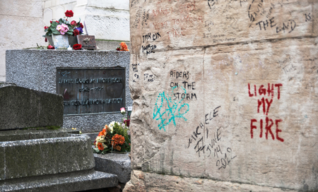 Grave of Jim Morrison (1943-1971), frontman of the american music band The Doors, located in the Pere Lachaise cemetery in Paris, France. The grave of the famous singer, songwriter and poet is a popul