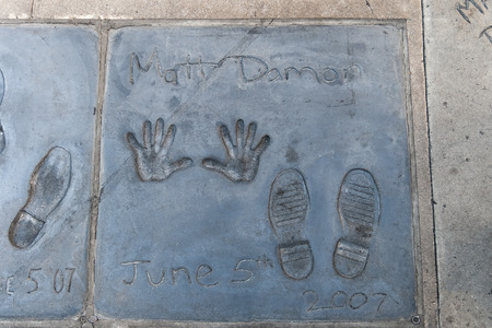 Handprints and footprints of the famous american actor Matt Damon on the ground behind TCL Grauman s Chinese Theater, Hollywood Boulevard, Los Angeles, California.