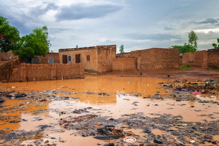 Flooded african slums with lots of garbage during the rainy season (july-august), Ouagadougou, Burkina Faso, West Africa.