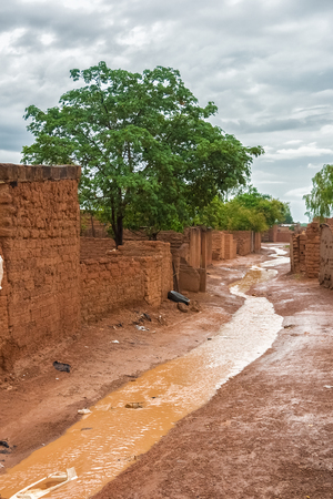 Flooded street in the slums of Ouagadougou, Burkina Faso, during the rainy season (july-august), West Africa.
