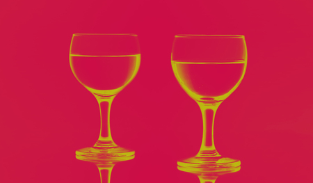 Shapes of two wine glasses isolated on solid pink red background with mirror reflection. Illustration style. Reklamní fotografie