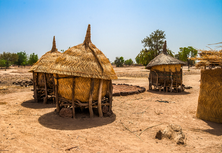 Traditional granaries made of woods and straw in an african village in Burkina Faso. They are on stilts to protect the crops against animals. 스톡 콘텐츠