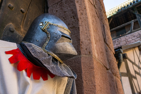 Medieval knight costume with helm, copy space on the right. Middle Ages concept.