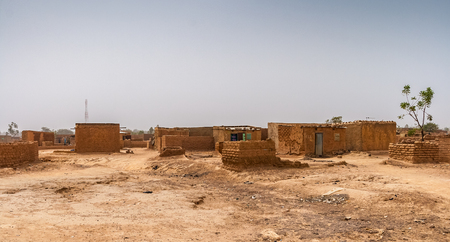 Ouagadougou township or slum. Eastern suburban illegal residential area with no electricity supply nor running water, Burkina Faso, West Africa. Stock Photo