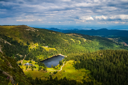 Vosges mountains summer landscape from the Gazon du Faing overlooking at the Forlet lake (or Lac des truites), France.