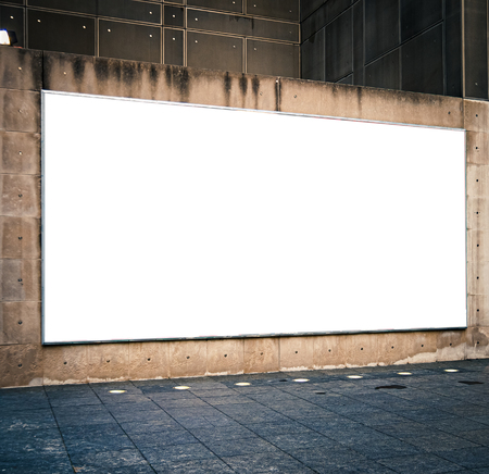 Large blank horizontal advertising bilboard mockup in city or town. Copy space.