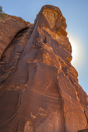 Sandstone rocky formation at Canyon de Chelly National Monument, with Anasazi petroglyphs. Vertical composition. Arizona, USA. Stock Photo
