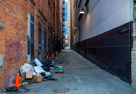 Dirty city alley with garbage. Downtown seattle. Municipality sanitation and public health.