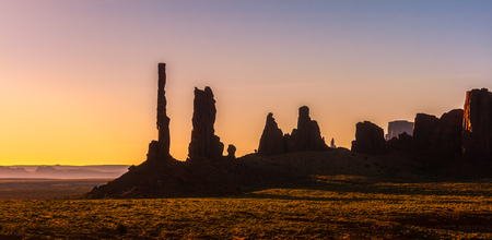 Monument Valley scenery at sunrise. Totem Pole and Yei Bi Chei rocky spires landscape. Monument Valley Navajo Tribal Park, USA.