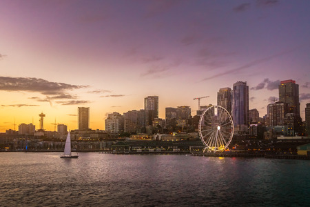 Beautiful Seattle waterfront skyline from Elliott Bay at dusk. Dreamy cityscape or scenery. Washington state, USA.