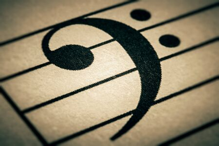 Bass clef or key sign on a musical chart or partition or part macro close-up. Banque d'images