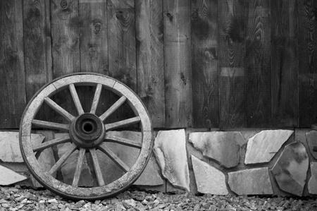 old wood farm wagon: Wagon wheel Stock Photo