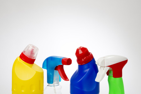 Plastic Cleaning Product Bottles with spot light background photo