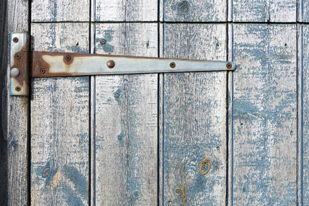 strap on: Strap hinge on old wooden stable door. Stock Photo