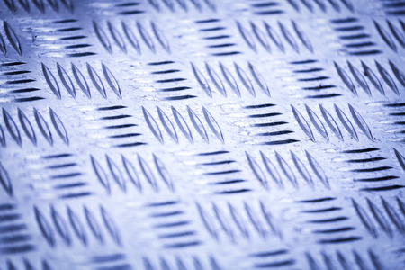 checkerplate: Diamond plate, also known as checker plate, tread plate, cross hatch kick plate and Durbar floor plate.