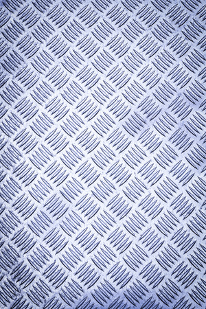 Diamond plate, also known as checker plate, tread plate, cross hatch kick plate and Durbar floor plate.