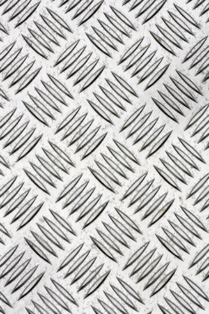checkerplate: Diamond plate, also known as checker plate, tread plate, cross hatch kick plate and Durbar floor plate.