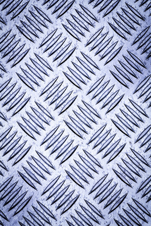 checker: Diamond plate, also known as checker plate, tread plate, cross hatch kick plate and Durbar floor plate.