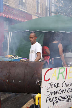 London, England - 30 August 2010 - Man cooking jerk chicken at the Notting Hill Carnival Stock Photo - 7798508